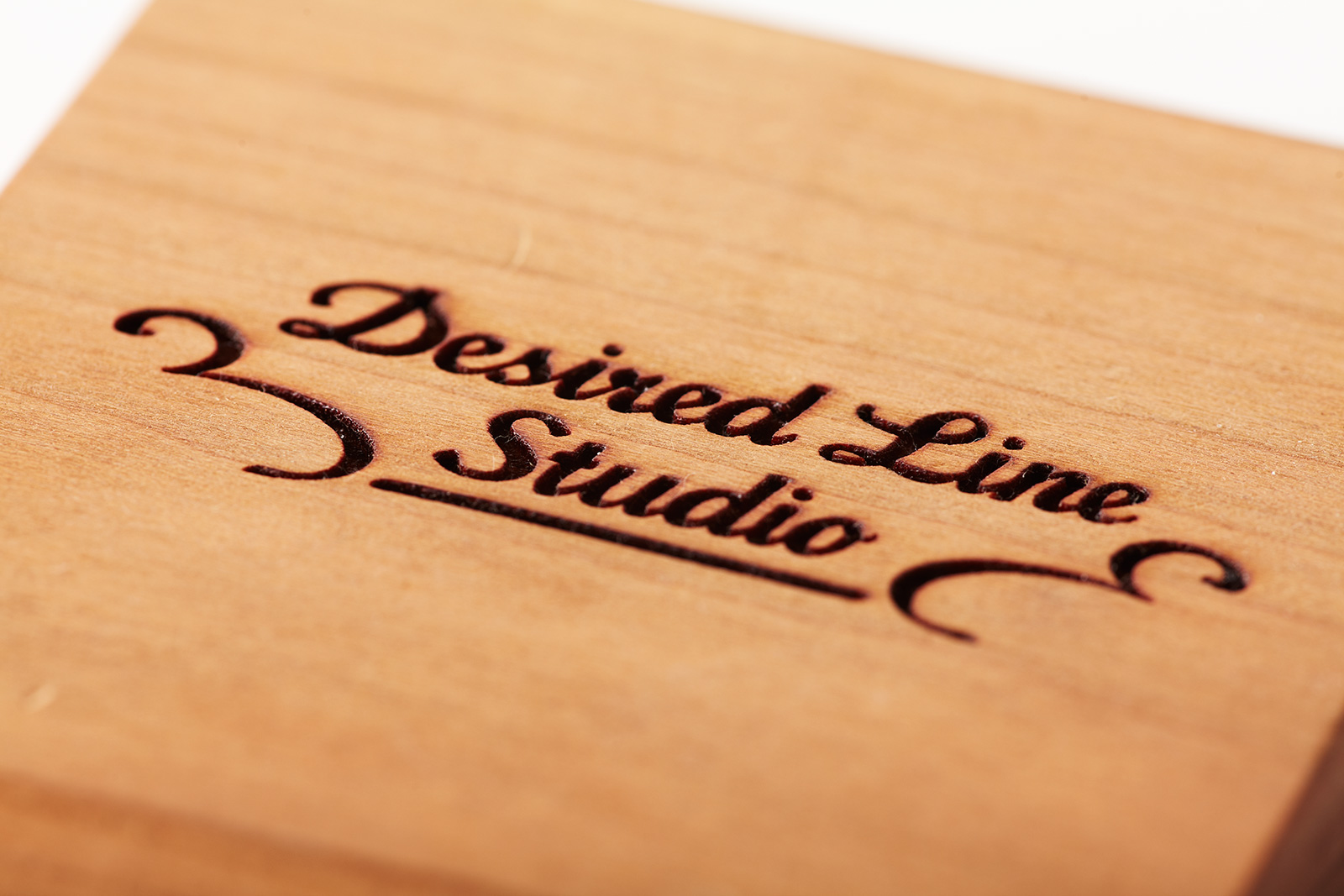 Wood plate with Desired Line Studio Logo